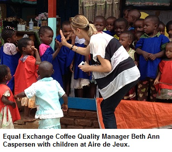 Equal Exchange Coffee Quality Manager Beth Ann Caspersen with children at Aire de Jeux