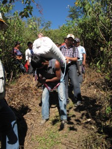 Escolastico Perez Gomez carrying coffee down from the farms.