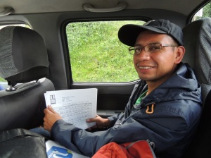 "Miguel, Sales Manager, Manos Campesinas Co-op, Guatemala. Here he is discussing last year's quality results in our ""on the go"" office in Quetzltenango, Guatemala."