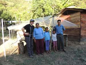 With Amando's family in front of his drying beds.