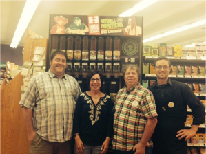 Phyllis Robinson with Matt Novick, Art Ames, and Daniel Esko (left to right) of Berkshire Co-op Market, the first co-op to join with us!