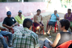 Alex Flores and Phyllis Robinson meeting with the farmers on Montecristo