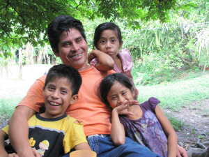 Victor Hugo Garcia Lopez relaxing with his children after offering me a tour of his organic coffee farm.
